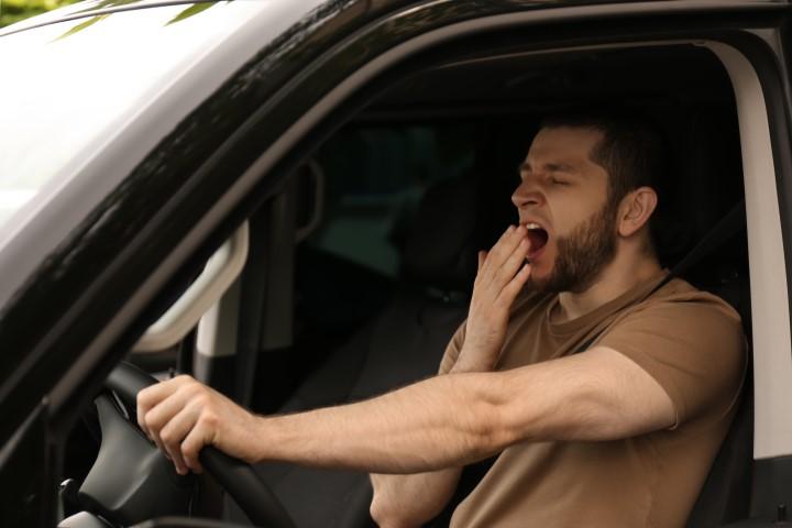 Tired-Man-in-Car-AdobeStock_361458380.jpeg